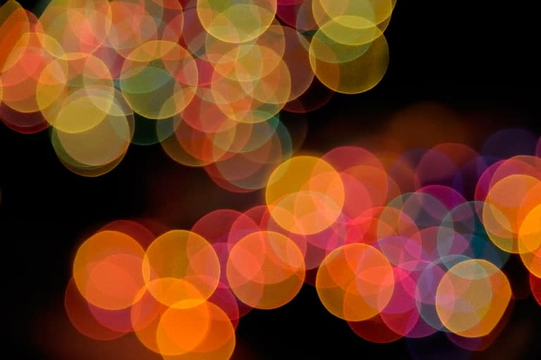 A classic shot that many photographers take is the out of focus or bokeh view of colorful holiday lights. Experiment with strands of color and white lights. Photo by: Lindsay Silverman