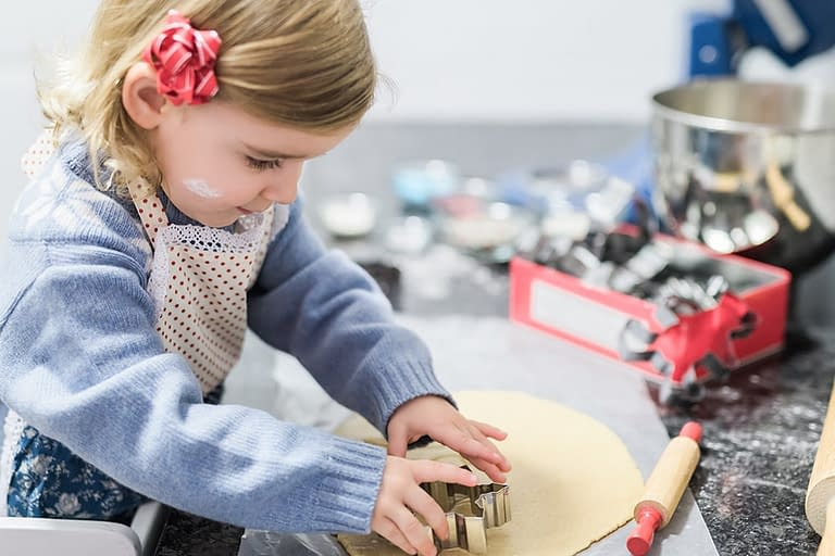 Capture candids of your young ones baking cookies, decorating or enjoying holiday festivities. Photo by: Kristina Kroot